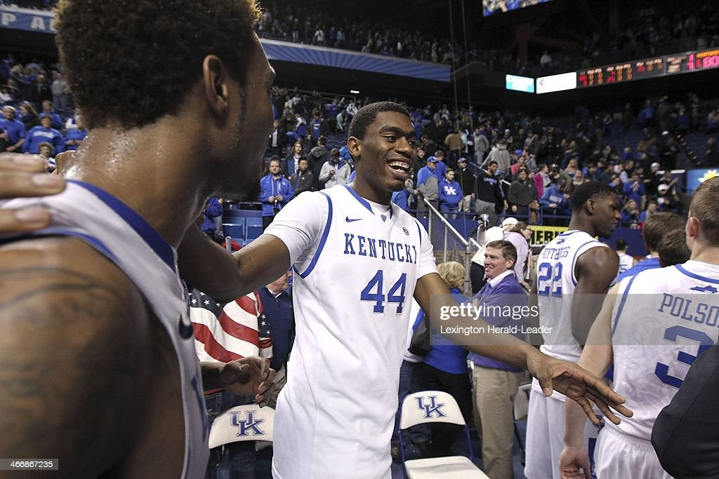 Kentucky Wildcats center Dakari Johnson and teammates including Kentucky Wildcats guard/forward James Young left leave the floor at the end of the...