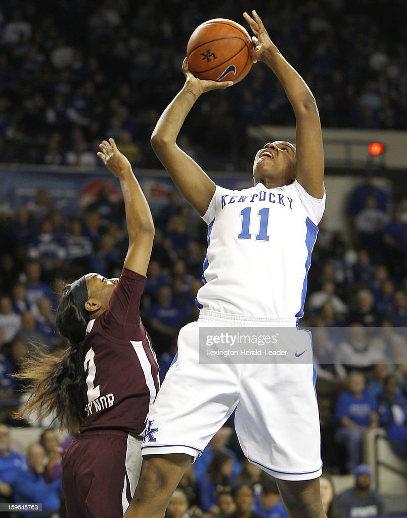 Kentucky Wildcats center DeNesha Stallworth (11) puts in a shot against the Mississippi State Bulldogs during a women's college basketball game at Rupp Arena on Thursday, January 17, 2013 in Lexington, Kentucky.