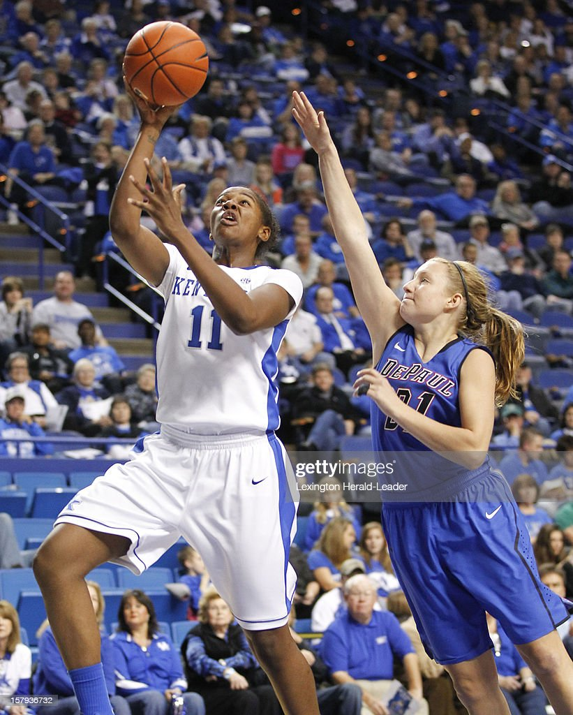 Kentucky Wildcats center DeNesha Stallworth (11) puts in a shot over DePaul Blue Demons guard Megan Rogowski (21) at Rupp Arena in Lexington, Kentucky, Friday, December 7, 2012. Kentucky defeated DePaul, 96-64.