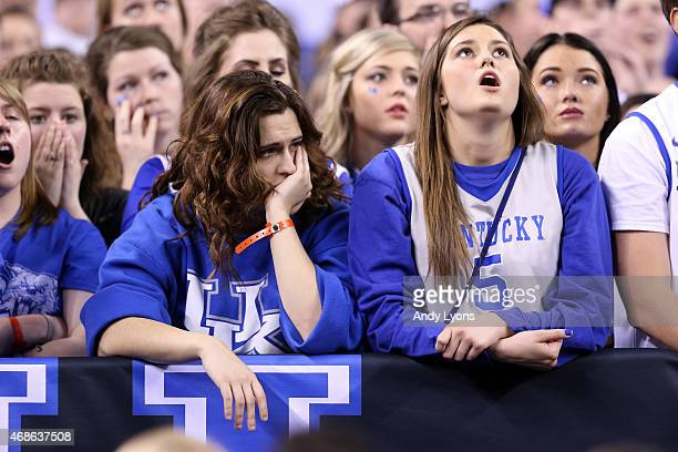 Kentucky Wildcats fans look on late in the game against the Wisconsin Badgers during the NCAA Men's Final Four Semifinal at Lucas Oil Stadium on...