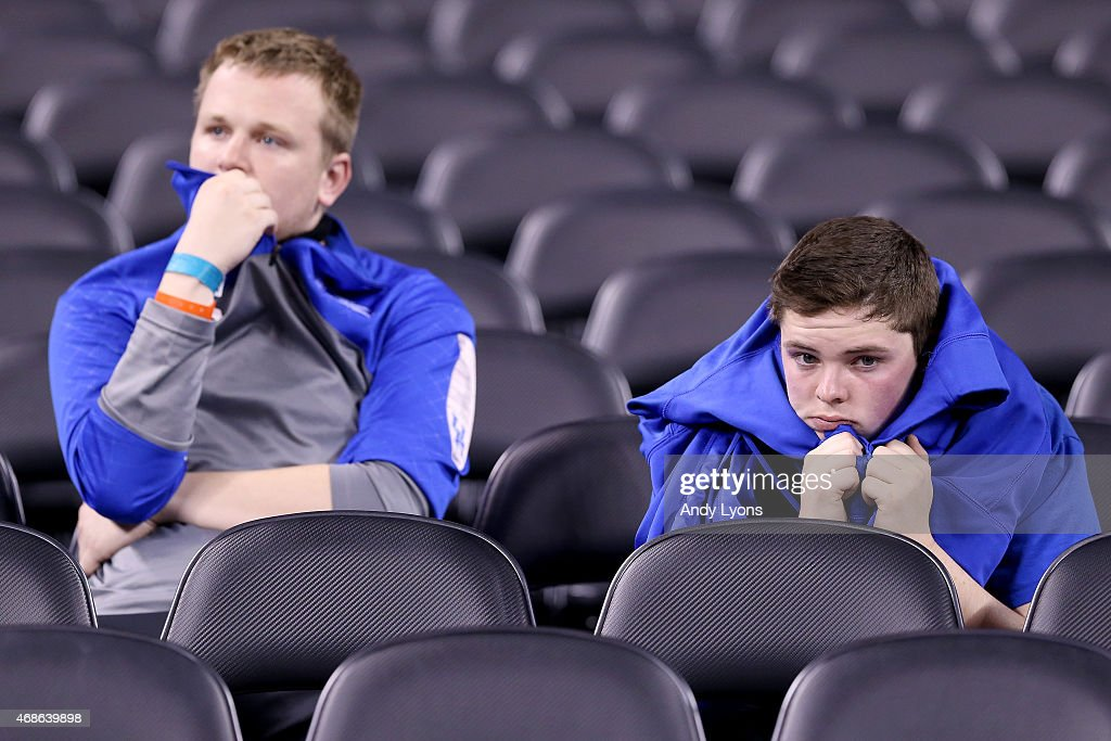 Kentucky Wildcats fans react in the stands after being defeated by the Wisconsin Badgers during the NCAA Men's Final Four Semifinal at Lucas Oil Stadium on April 4, 2015 in Indianapolis, Indiana. Wisconsin defeated Kentucky 71-64.
