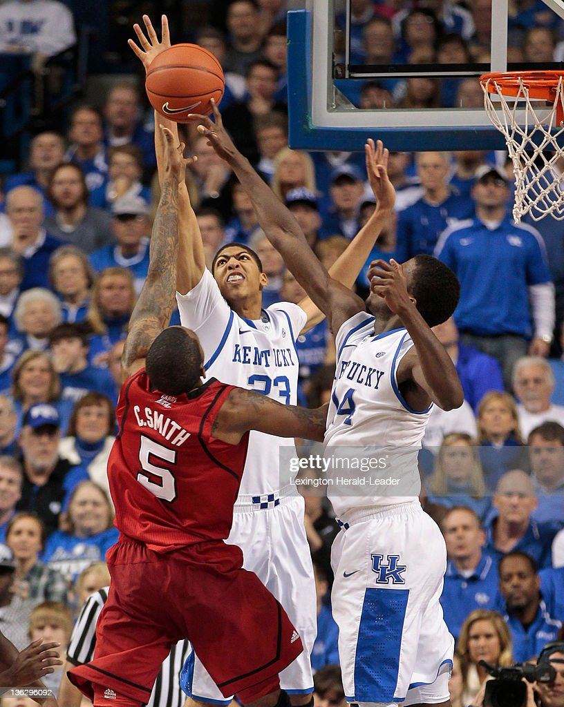 Kentucky Wildcats forward Anthony Davis blocks the shot of Louisville Cardinals guard Chris Smith during game action at Rupp Arena in Lexington...