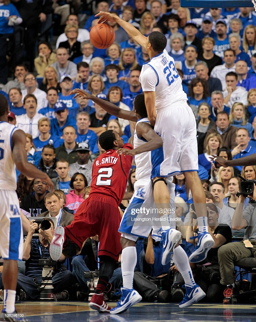 Kentucky Wildcats forward Anthony Davis blocks the shot of Louisville Cardinals guard Russ Smith during game action against Louisville at Rupp Arena...