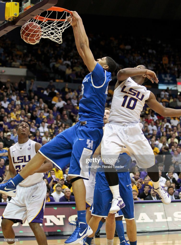 Kentucky Wildcats forward Anthony Davis dunks on LSU Tigers guard Andre Stringer for two of his 16 points during the game at Pete Maravich Assembly...