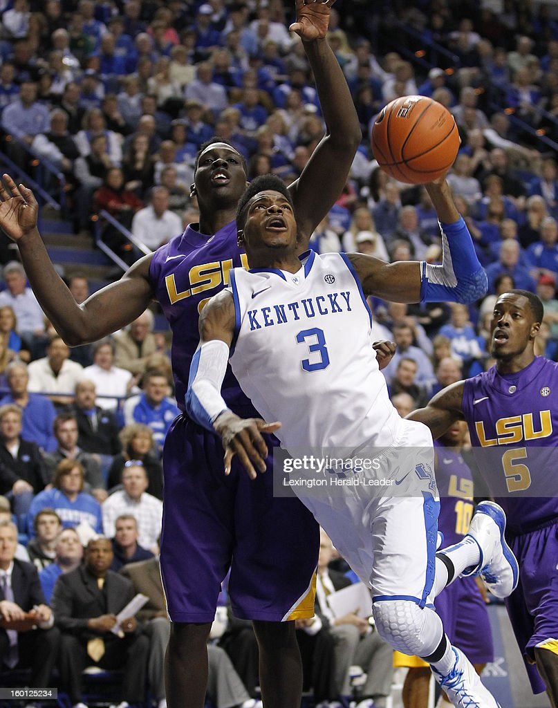 Kentucky Wildcats forward Nerlens Noel (3) draws contact from LSU Tigers forward Johnny O'Bryant III (2) during game action at Rupp Arena in Lexington, Kentucky, Saturday, January 26, 2013. Kentucky defeated LSU