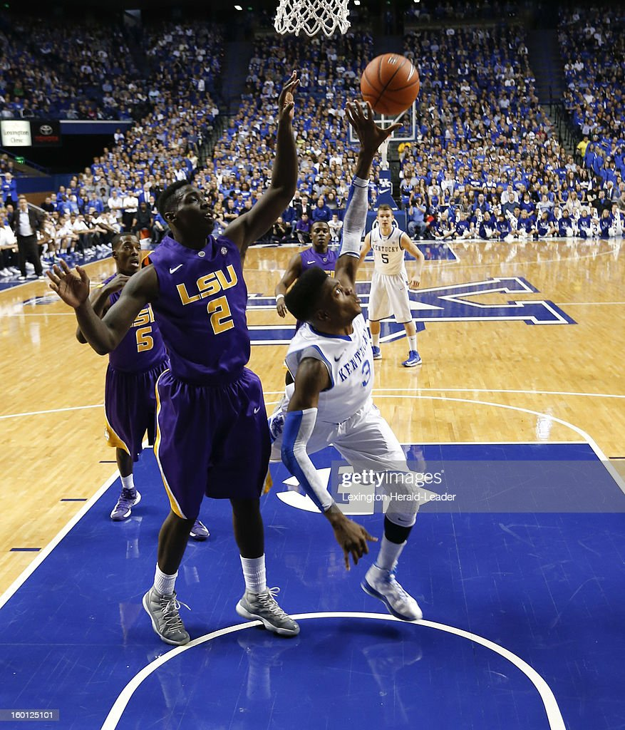Kentucky Wildcats forward Nerlens Noel (3) gets knocked around by LSU Tigers forward Johnny O'Bryant III (2) on a drive to the basket at Rupp Arena in Lexington, Kentucky, Saturday, January 26, 2013. Kentucky defeated LSU
