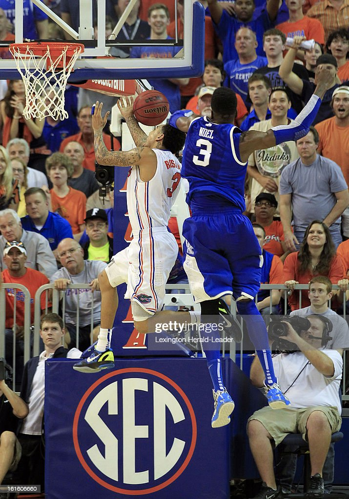 Kentucky Wildcats forward Nerlens Noel (3) injured his leg on this play, while trying to block a shot by Florida Gators guard Mike Rosario (3) in the second half at the O'Connell Center in Gainesville, Florida, Tuesday, February 12, 2013. Florida defeated UK