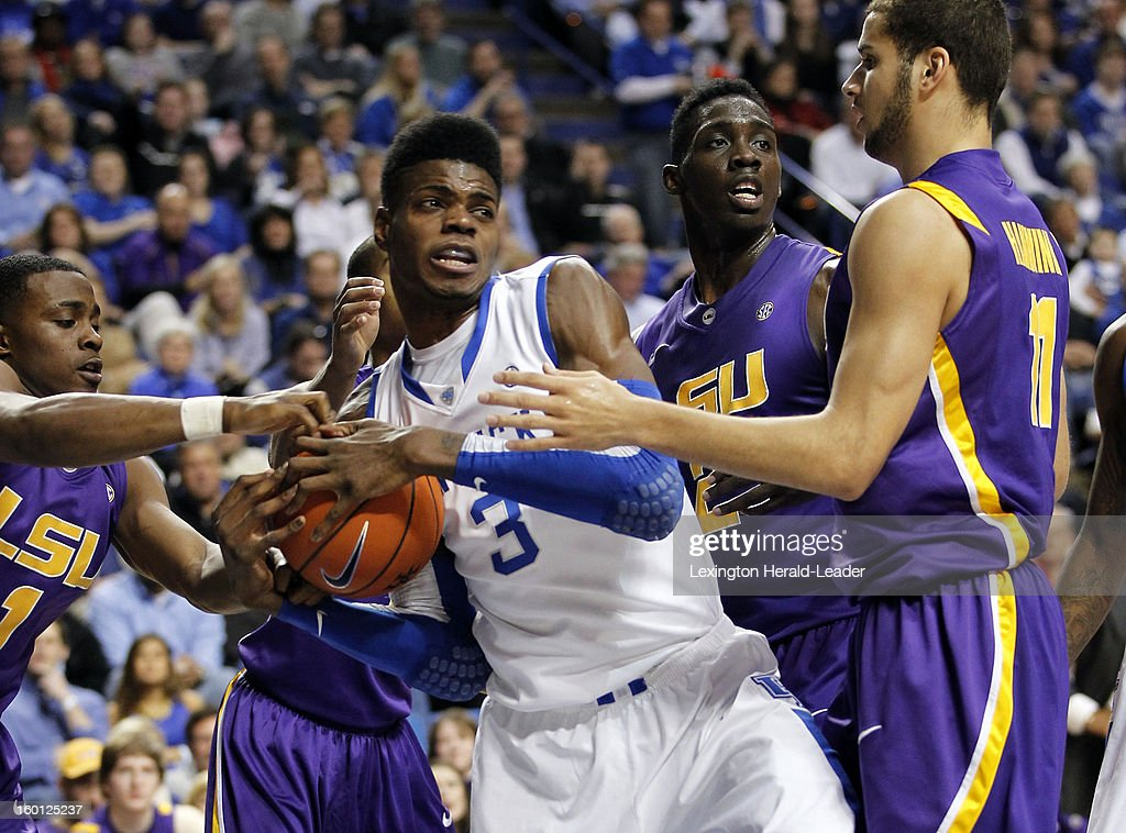 Kentucky Wildcats forward Nerlens Noel (3) tries to clear the ball in LSU traffic during game action at Rupp Arena in Lexington, Kentucky, Saturday, January 26, 2013. Kentucky defeated LSU