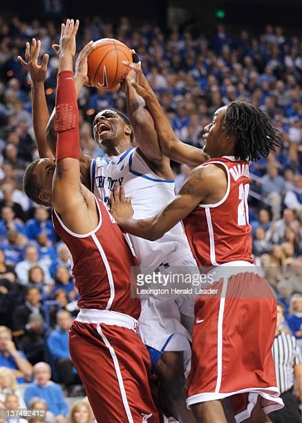 Kentucky Wildcats forward Terrence Jones center gets sandwiched by Alabama Crimson Tide forward Nick Jacobs left and Alabama guard Levi Randolph...
