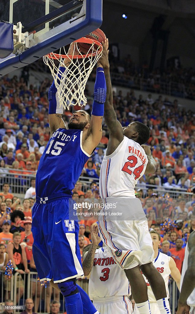 Kentucky Wildcats forward Willie Cauley-Stein (15) has his dunk blocked by Florida Gators defender Casey Prather (24) in the second half at the O'Connell Center in Gainesville, Florida, Tuesday, February 12, 2013. Florida defeated UK