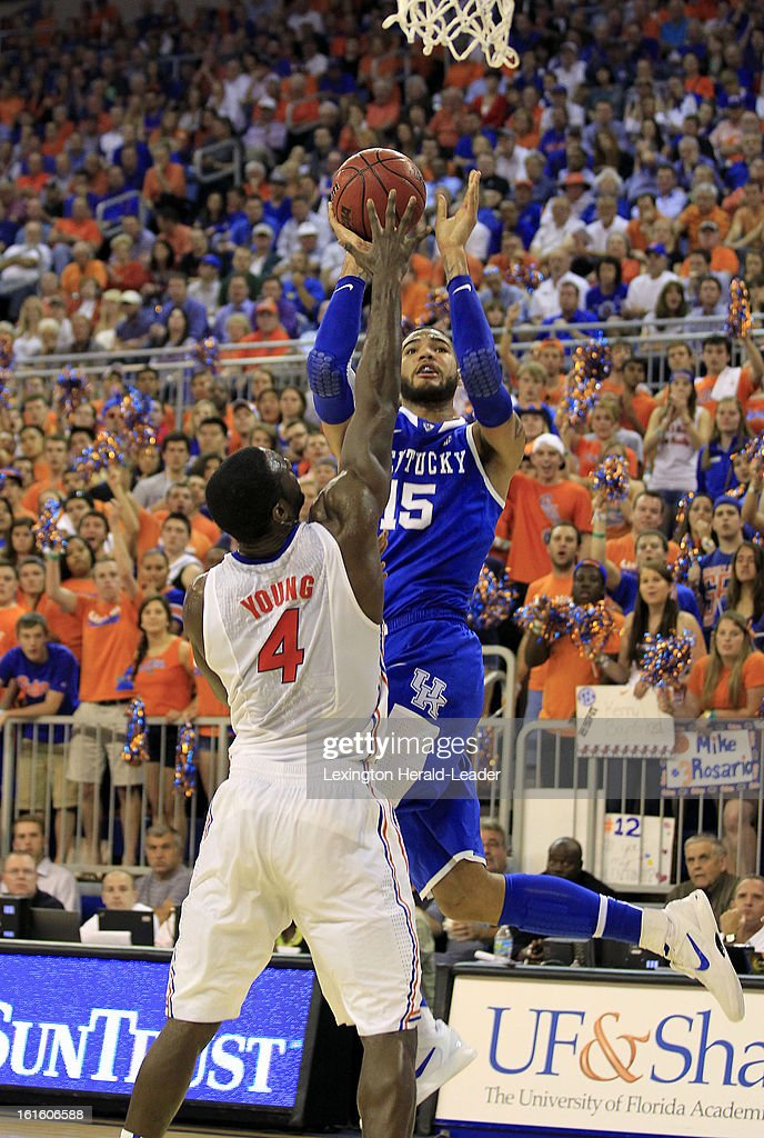 Kentucky Wildcats forward Willie Cauley-Stein (15) shoots in front of Florida Gators center Patric Young (4) in the first half at the O'Connell Center in Gainesville, Florida, Tuesday, February 12, 2013. Florida defeated UK