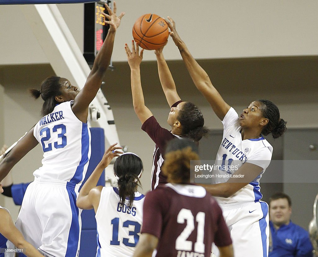 Kentucky Wildcats forward/center Samarie Walker (23) and DeNesha Stallworth (11) block the shot of Mississippi State Bulldogs guard Katia May (11) during a women's college basketball game at Rupp Arena on Thursday, January 17, 2013 in Lexington, Kentucky.