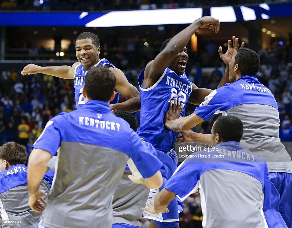 Kentucky Wildcats guard Aaron Harrison and Alex Poythress celebrate at the end of the game against the Wichita State Shockers during the third round...
