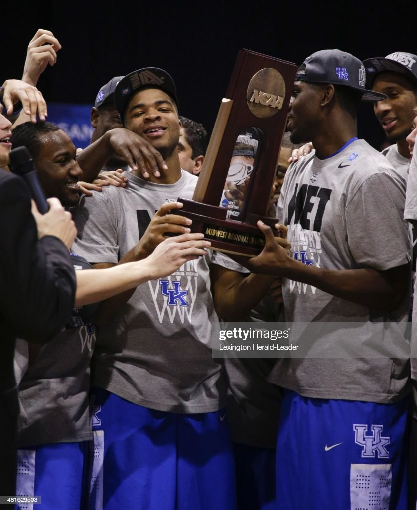 Kentucky Wildcats guard Aaron Harrison and his team raised the trophy The Kentucky Wildcats defeated the Michigan Wolverines 7572 during the NCAA...