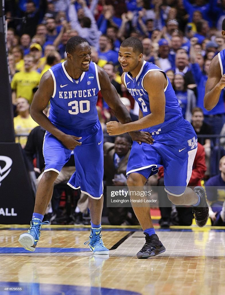 Kentucky Wildcats guard Aaron Harrison and Julius Randle celebrated after Harrison hit the gamewinning shot The Kentucky Wildcats defeated the...