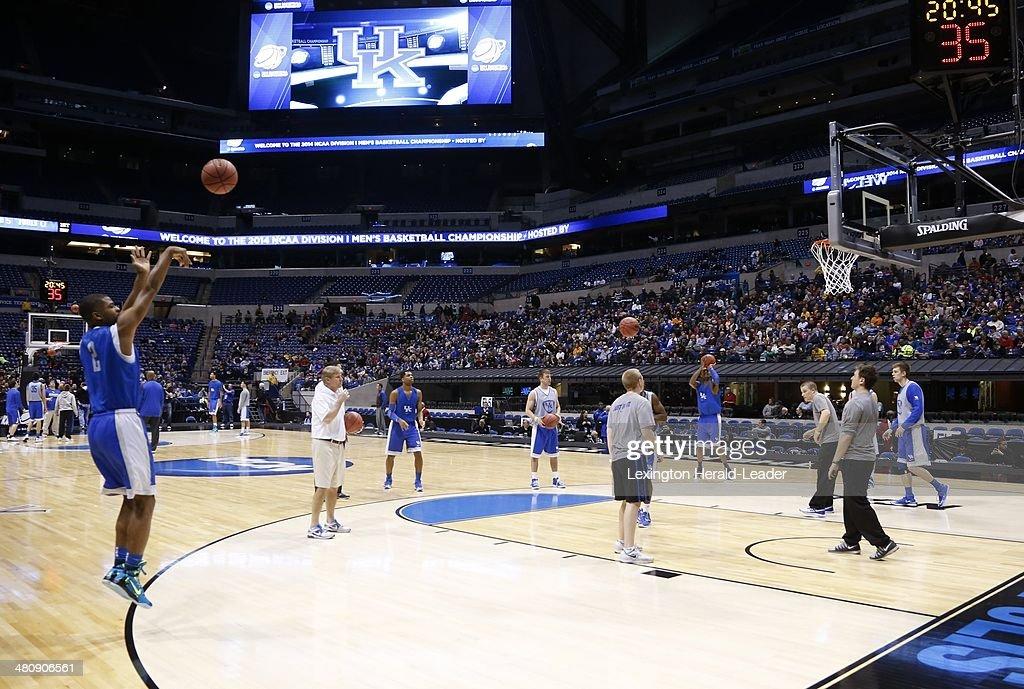 Kentucky Wildcats guard Aaron Harrison attempts a 3pointer during shoot around as Kentucky practiced at Lucas Oil Stadium on Thursday March 27 2014...