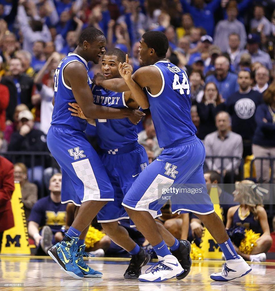 Kentucky Wildcats guard Aaron Harrison center reacts with teammates Kentucky Wildcats forward Julius Randle left and Kentucky Wildcats center Dakari...