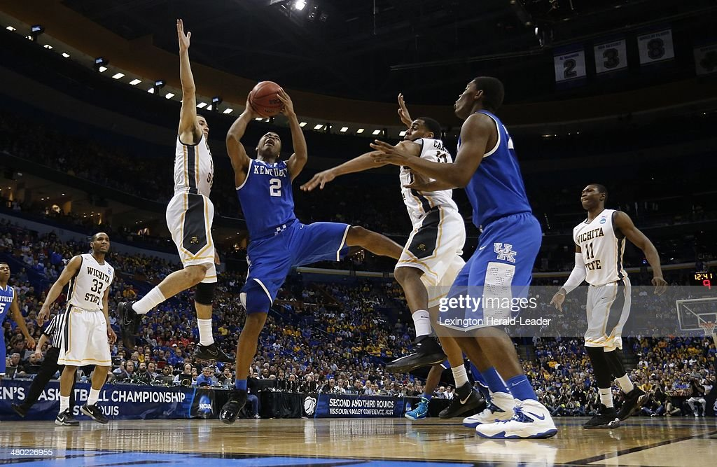 Kentucky Wildcats guard Aaron Harrison cuts inside for a basket for two of his 19 points against the Wichita State Shockers during the third round of...