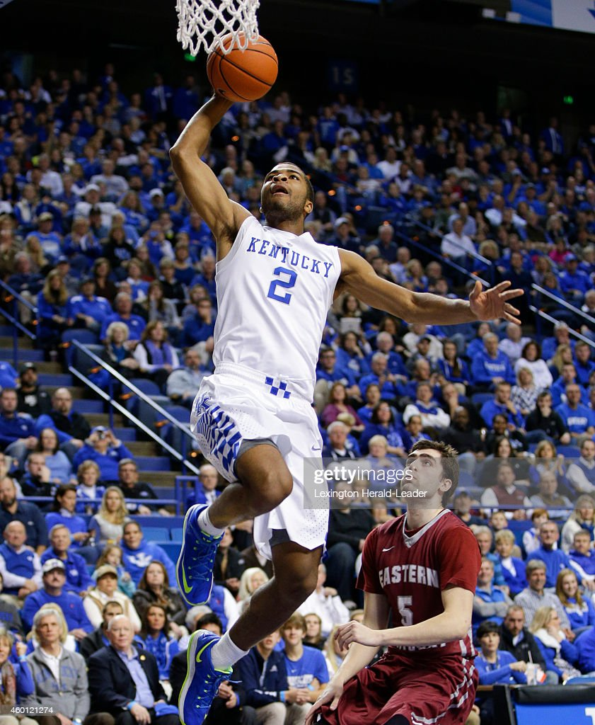 Kentucky Wildcats guard Aaron Harrison drives in for a dunk on the fast break on Sunday Dec 7 in Lexington Ky