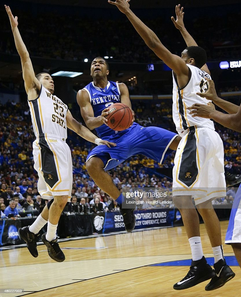 Kentucky Wildcats guard Aaron Harrison drives the lane for a basket against the Wichita State Shockers during the third round of the NCAA Tournament...