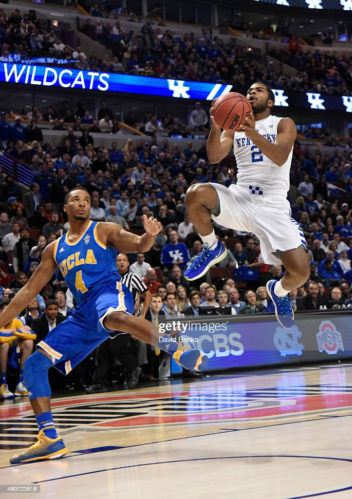 Kentucky Wildcats guard Aaron Harrison goes up for a shot as UCLA Bruins guard Norman Powell trails the play during the first half of the CBS Sports...