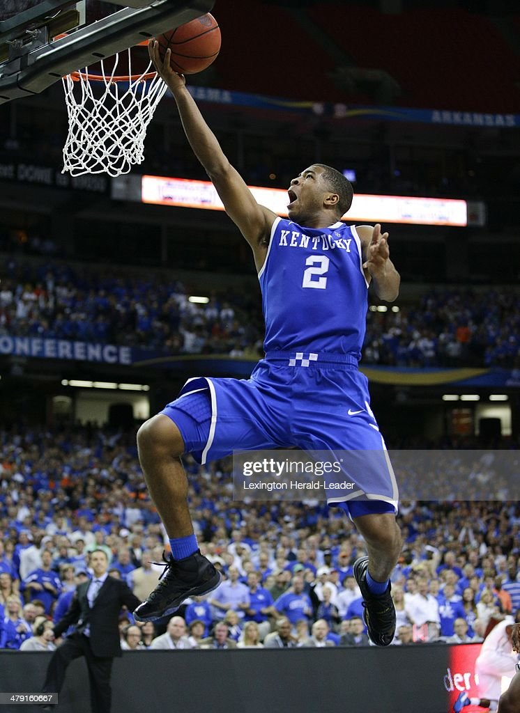 Kentucky Wildcats guard Aaron Harrison hits a basket against the Florida Gators in the Southeastern Conference Tournament on Sunday March 16 in...