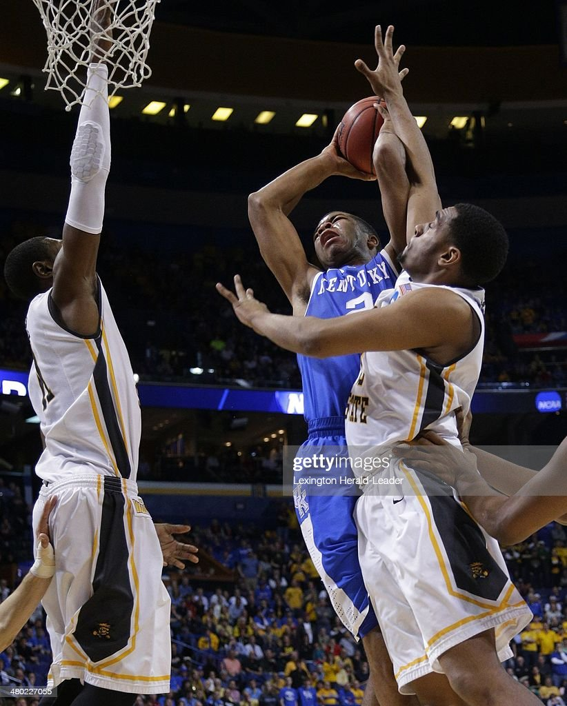 Kentucky Wildcats guard Aaron Harrison is fouled as he drives into the lane during the third round of the NCAA Tournament in St Louis on Sunday March...