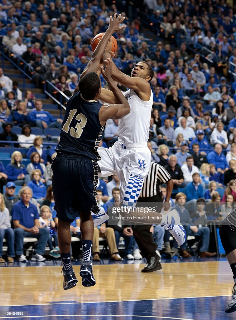 Kentucky Wildcats guard Aaron Harrison is fouled by Montana State Bobcats forward Terrell Brown during the second half on Sunday Nov 23 at Rupp Arena...