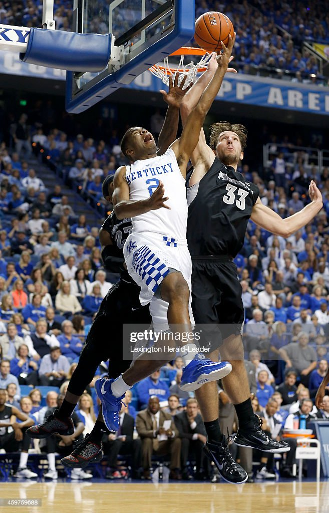 Kentucky Wildcats guard Aaron Harrison is fouled by Providence Friars forward Carson Desrosiers during the first half on Sunday Nov 30 at Rupp Arena...