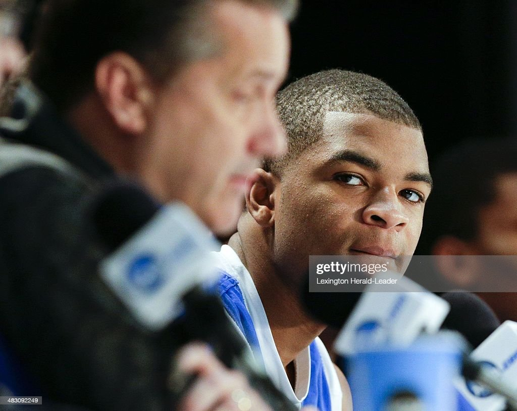 Kentucky Wildcats guard Aaron Harrison listened to Coach John Calipari speak to the media during a news conference at ATT Stadium in Arlington Texas...
