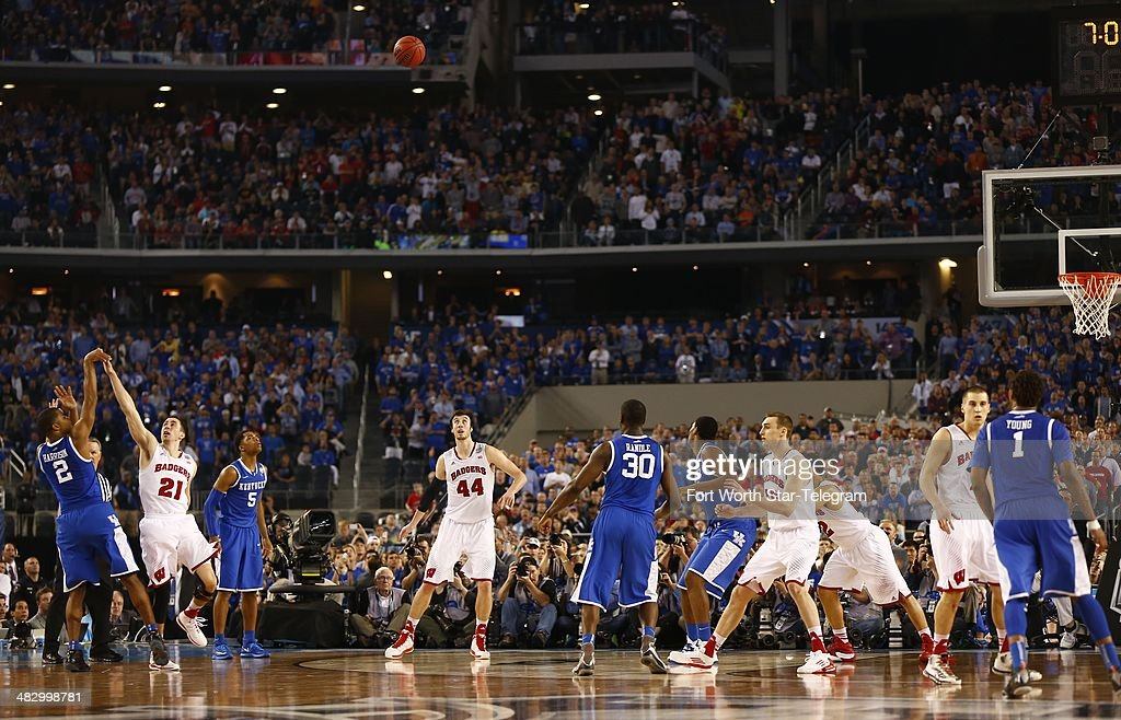 Kentucky Wildcats guard Aaron Harrison makes a threepoint shot in the closing seconds as the Kentucky Wildcats beat the Wisconsin Badgers 7473 in the...