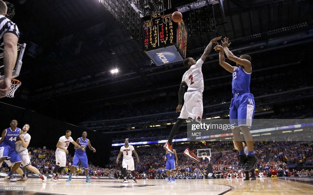 Kentucky Wildcats guard Aaron Harrison nails this 3pointer with less than a minute to go in the game to give Kentucky a 2point lead over Louisville...