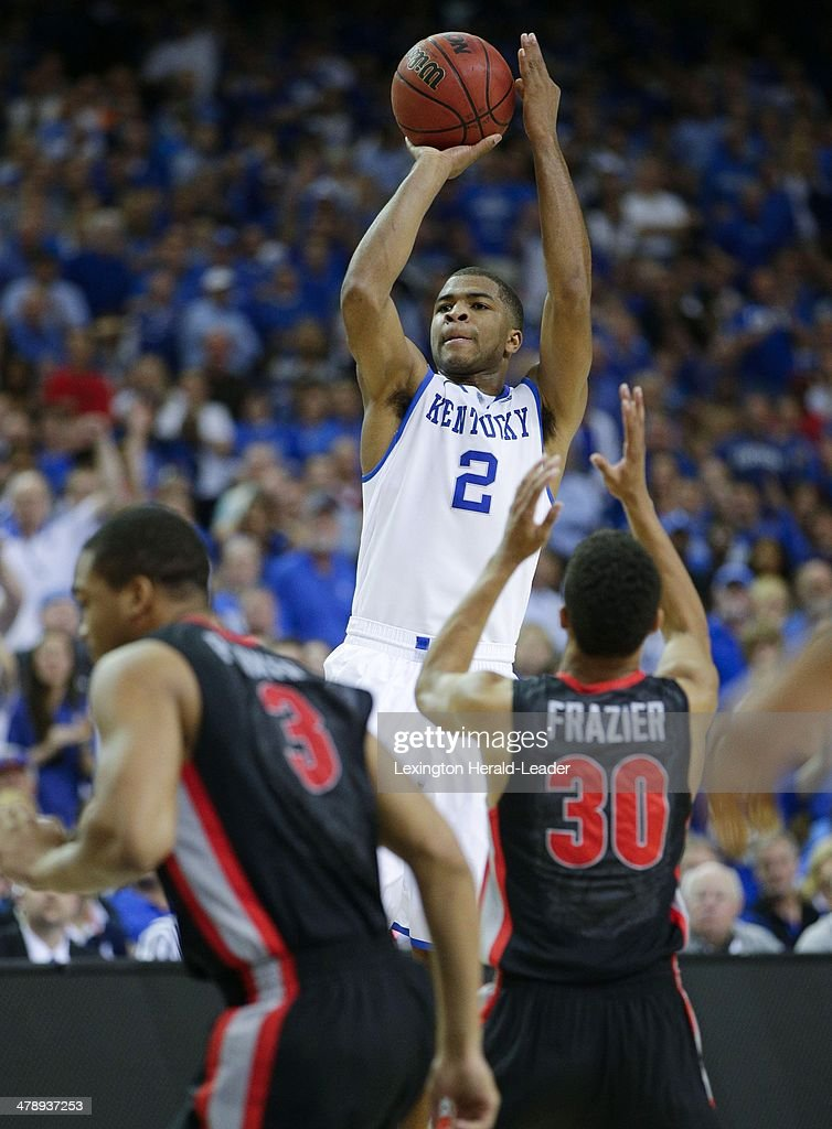 Kentucky Wildcats guard Aaron Harrison puts in three of his 22 points against Georgia in a semifinal of the SEC Basketball Tournament in Atlanta...