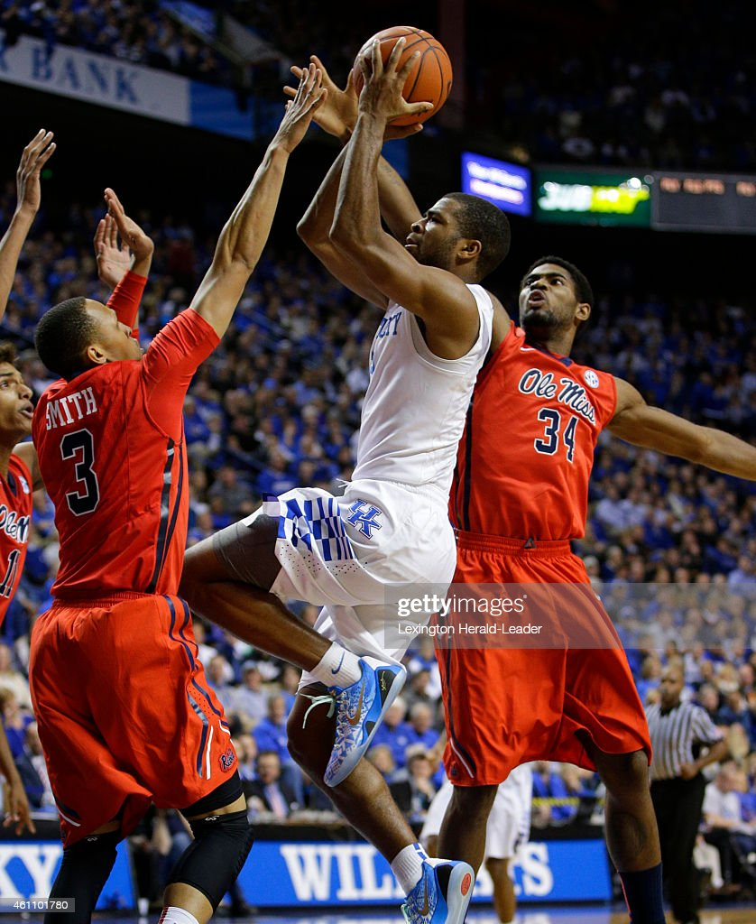 Kentucky Wildcats guard Aaron Harrison puts up a shot in traffic over Mississippi Rebels guard Terence Smith finishing with 29 points on Tuesday Jan...
