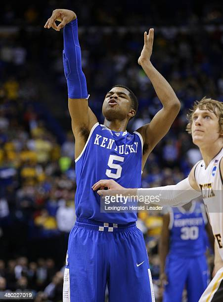 Kentucky Wildcats guard Andrew Harrison grimaces as he misfires on the second of two free throws in the final seconds of the third round of the NCAA...