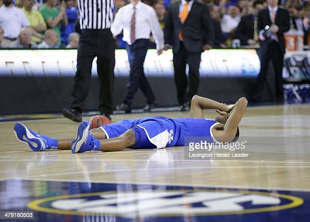 Kentucky Wildcats guard Andrew Harrison lays on the floor as time expires in the Southeastern Conference Tournament on Sunday March 16 in Atlanta The...