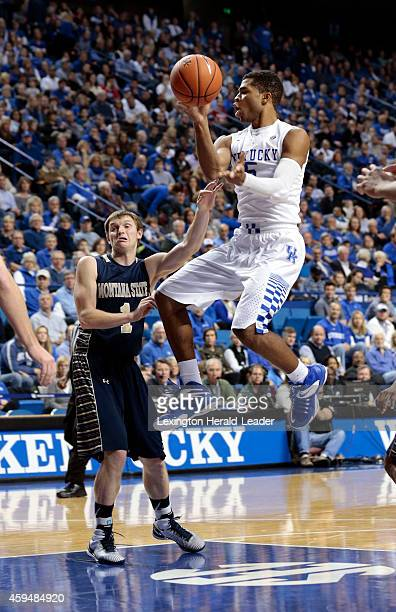 Kentucky Wildcats guard Andrew Harrison makes a nolook pass in front of Montana State Bobcats guard Stephan Holm during the second half on Sunday Nov...