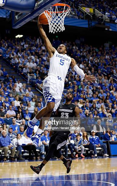 Kentucky Wildcats guard Andrew Harrison scores on a breakaway past Providence Friars forward LaDontae Henton during the second half on Sunday Nov 30...