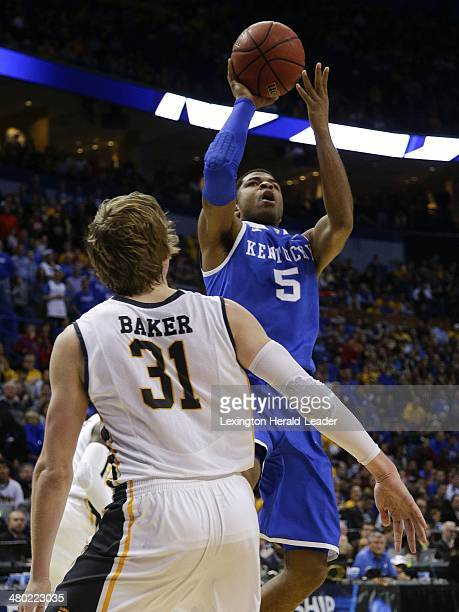 Kentucky Wildcats guard Andrew Harrison scores two of his 20 points against the Wichita State Shockers during the third round of the NCAA Tournament...