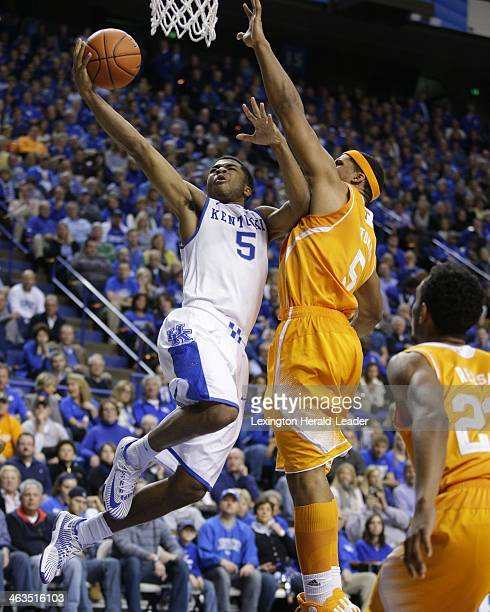 Kentucky Wildcats guard Andrew Harrison slices under Tennessee forward Jarnell Stokes for two of his 26 points in the game at Rupp Arena in Lexington...