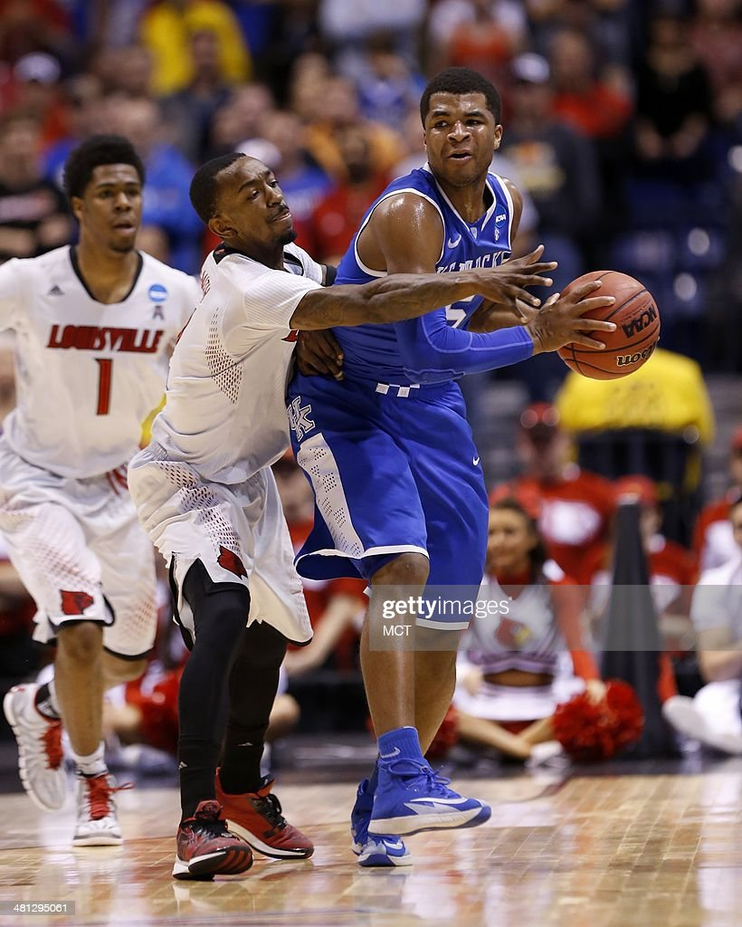 Kentucky Wildcats guard Andrew Harrison tries to get past Louisville Cardinals guard Russ Smith Louisville takes on Kentucky in the NCAA Midwest...