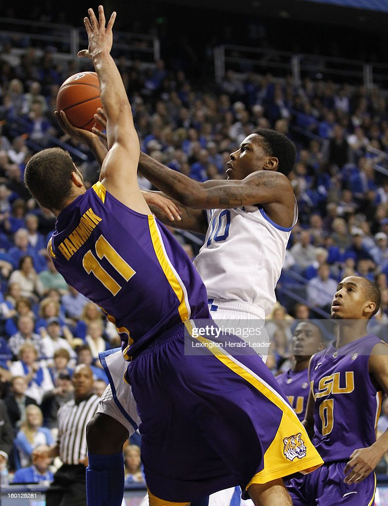 Kentucky Wildcats guard Archie Goodwin (10) draws a foul from LSU Tigers forward Shane Hammink (11), as he drove to the basket, during game action at Rupp Arena in Lexington, Kentucky, Saturday, January 26, 2013. Kentucky defeated LSU