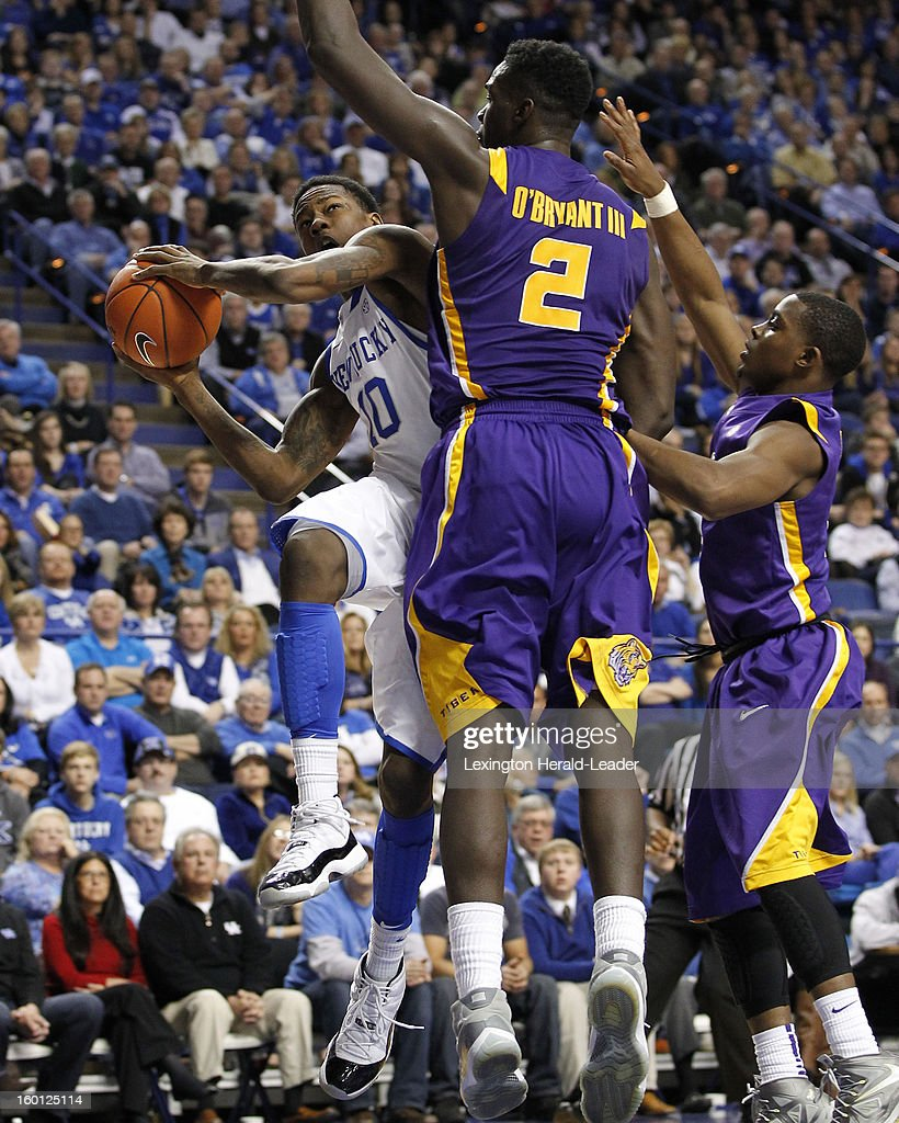 Kentucky Wildcats guard Archie Goodwin (10) drives the lane against LSU Tigers forward Johnny O'Bryant III (2) during game action at Rupp Arena in Lexington, Kentucky, Saturday, January 26, 2013. Kentucky defeated LSU