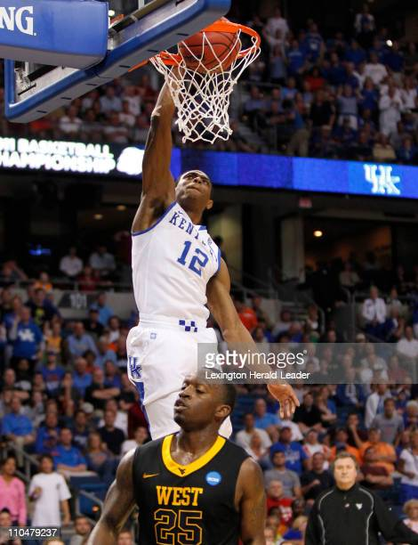 Kentucky Wildcats guard Brandon Knight dunked over West Virginia Mountaineers guard Darryl Bryant during the third round of the men's NCAA basketball...
