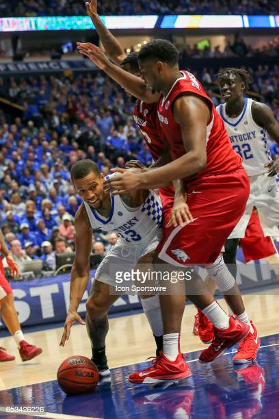 Kentucky Wildcats guard Isaiah Briscoe gets double teamed moving to the basket during second half action in the Southeastern Conference Basketball...