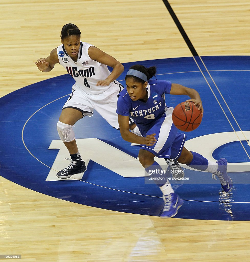 Kentucky Wildcats guard Janee Thompson (3) brings the ball up court past Connecticut Huskies guard Moriah Jefferson (4) during first-half action in the NCAA women's regional finals at Webster Bank Arena in Bridgeport, Connecticut, Monday, April 01, 2013.