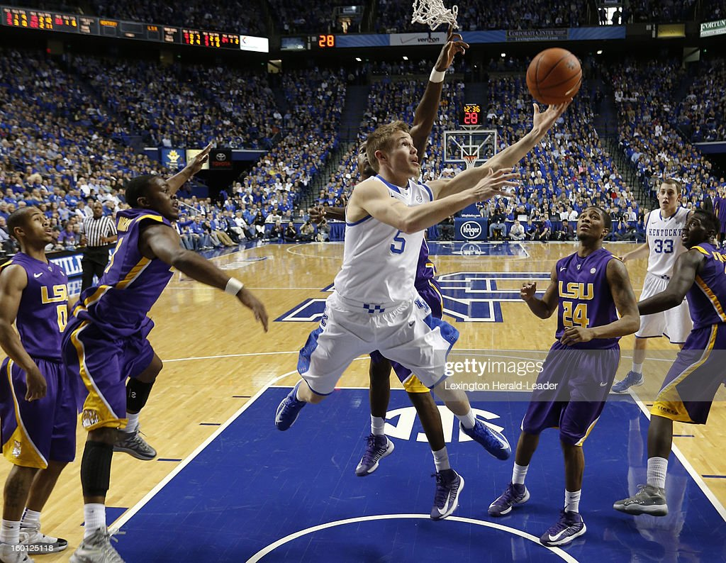 Kentucky Wildcats guard Jarrod Polson (5) drives the lane for a basket against LSU at Rupp Arena in Lexington, Kentucky, Saturday, January 26, 2013. Kentucky defeated LSU