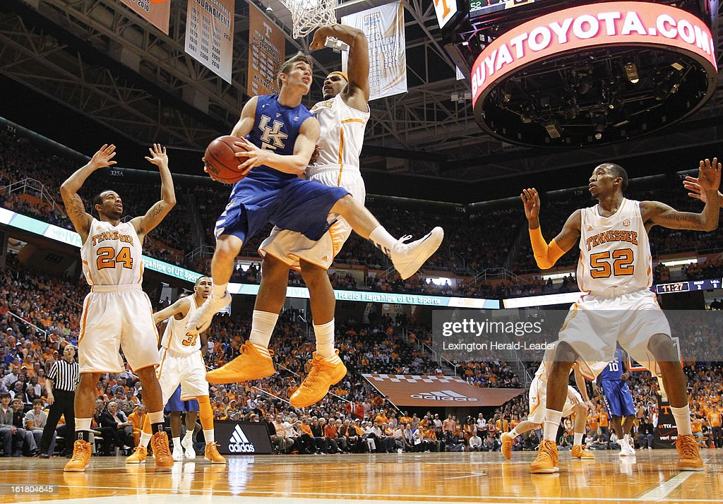 Kentucky Wildcats guard Jarrod Polson (5) gets caught under the basket against the Tennessee defense during game action at Thompson-Boling Arena in Knoxville, Tennessee, Saturday, February 16, 2013. Tennessee defeated Kentucky, 88-58.