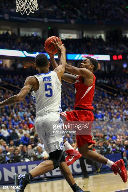 Kentucky Wildcats guard Malik Monk fouls Arkansas Razorbacks guard Daryl Macon while shooting the ball during the first half of the Southeastern...