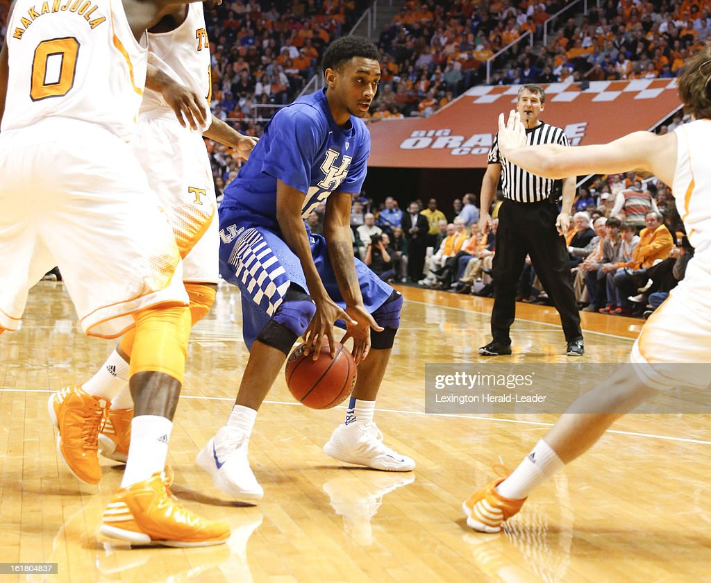 Kentucky Wildcats guard Ryan Harrow (12) loses the ball in traffic during the game against Tennessee at Thompson-Boling Arena in Knoxville, Tennessee, Saturday, February 16, 2013. Tennessee defeated Kentucky, 88-58.